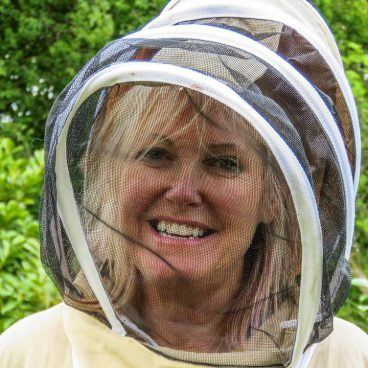 Picture of Sharon Jervis in bee keepers outfit